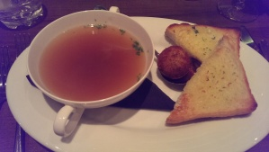 The lovely lobster consomme with some garlic toast and a tastylobster dumpling