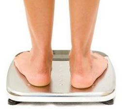 weighing yourself on the bathroom scales