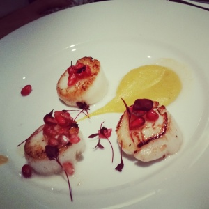 A starter of pan seared scallops